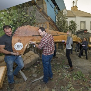Canadian Museum of History staff carry the seven metre canoe.