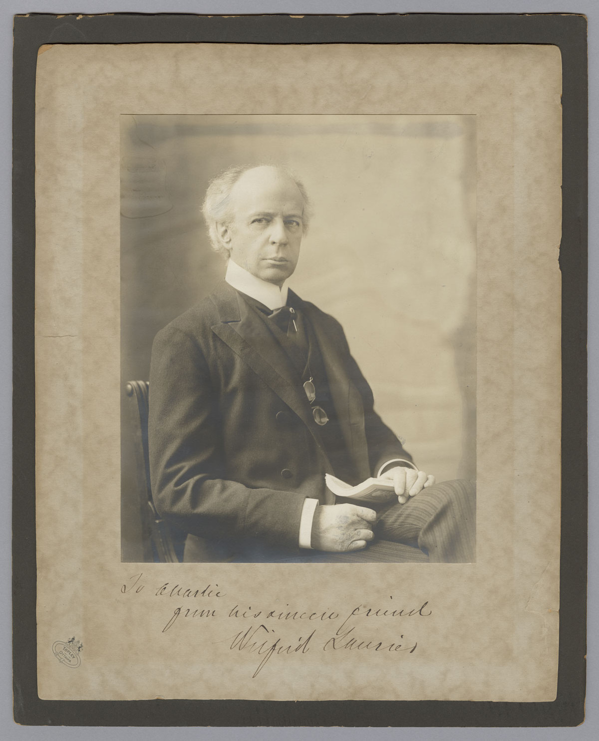 """Black and white photograph of Laurier, inscribed to his friend """"Charlie,"""" undated. Canadian Museum of History, 2014-H0010, H-412. Gift of Juliana Ovens."""
