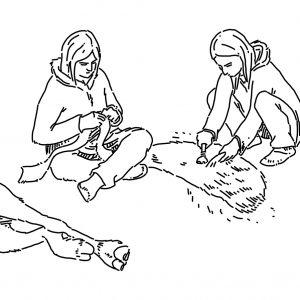 Une femme utilise un grattoir en pierre